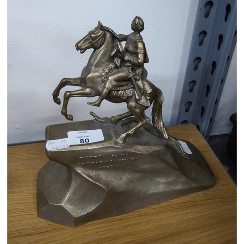 80 - A METAL EQUESTRIAN GROUP ON ROCKWORK STYLE BASE...