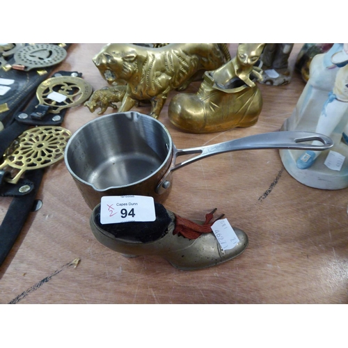 94 - A PIN CUSHION IN THE FORM OF A HIGH-HEELED SHOE AND A SMALL COPPER PAN WITH STEEL HANDLE (2)...