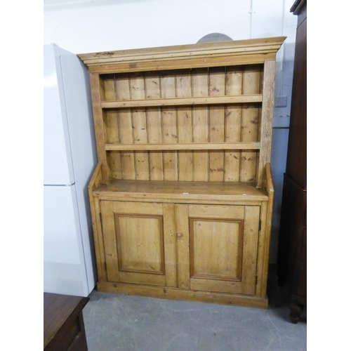 181 - LARGE ANTIQUE PINE KITCHEN DRESSER, HAVING CUPBOARD DOORS, SHELVING AND SHAPED TOP...