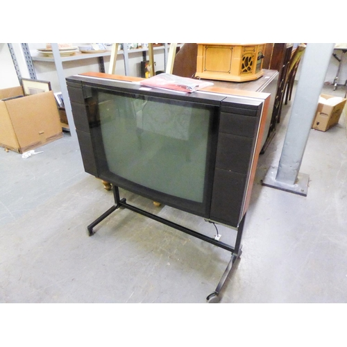 223 - BANG AND OLUFSEN 'BEOVISION LX2500' COLOUR TELEVISION ON STAND, HAVING REMOTE CONTROL AND TWO INSTRU...