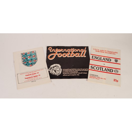 31 - THREE ENGLAND UNDER 21s PROGRAMMES, v Scotland at Bramhall Lane 1977, v Yugoslavia Maine Road 19788 ...