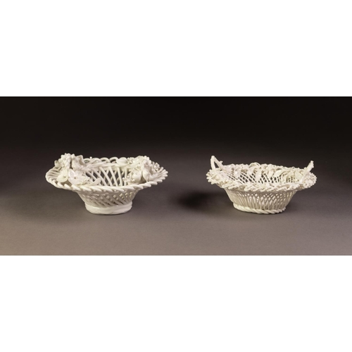 40 - FLORAL ENCRUSTED PORCELAIN BASKET, of circular wire pattern with four upright loop handles to the en...