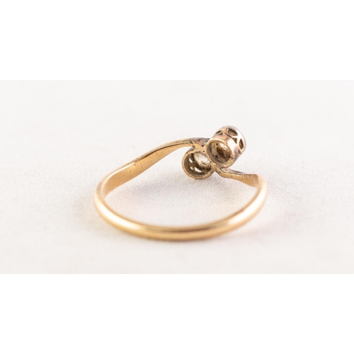 46 - VICTORIAN GOLD CROSSOVER RING, collet set with two old cut diamonds, approx .30ct in total, 2.2gms, ...