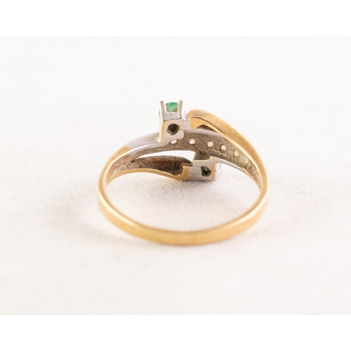 48 - 18ct GOLD, EMERALD AND DIAMOND TRIPLE CROSSOVER RING, the top set with a row of seven tiny diamonds ...