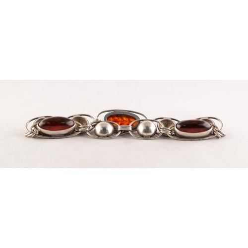 53 - A SILVER NINE LINK BRACELET, three of the links set with cabochon oval amber, hook fastening...