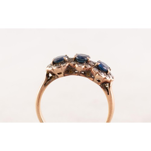 57 - 14ct GOLD, SAPPHIRE AND DIAMOND TRIPLE CLUSTER RING set with three oval sapphires surrounded by twen...
