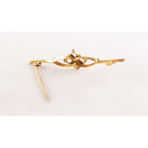 57A - 9ct GOLD BAR BROOCH, the open work centre having a floral motif, 2in (5cm) wide, 1.2gms