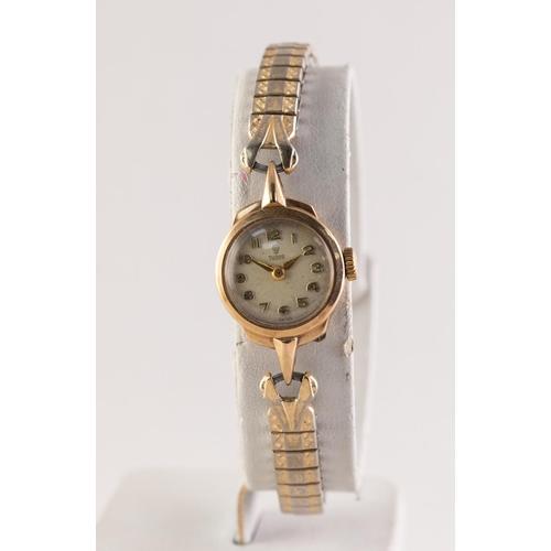 15 - LADY'S TUDOR 9ct GOLD CASED WRIST WATCH, 17 rubies, Arabic dial, Edinburgh 1963, on an expanding gol...
