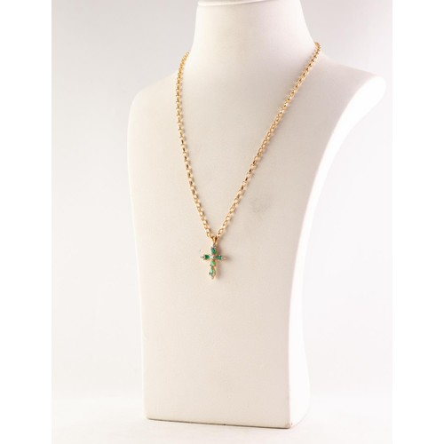 55 - 18ct GOLD, EMERALD AND DIAMOND CROSS PENDANT, set with a small centre diamond, approximately 0.07ct,...