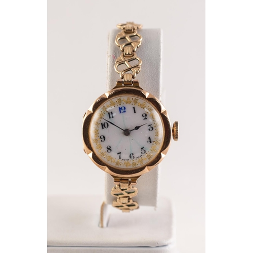 26 - RIVAL, LADY'S 9ct GOLD WRISTWATCH with 15 jewels movement, gilt decorated white porcelain Arabic dia...