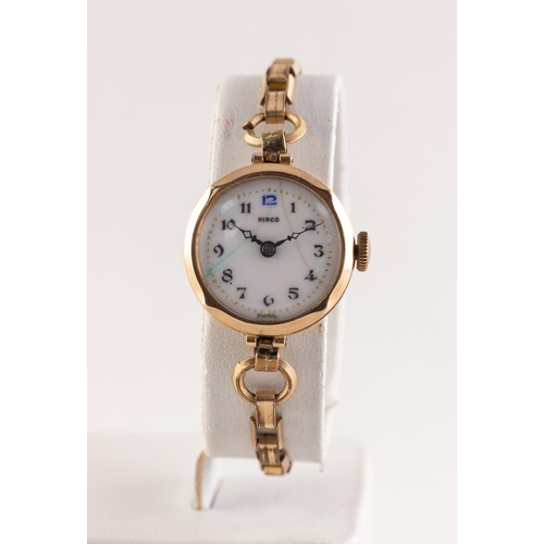 27 - HIRCO LADY'S 9ct GOLD SWISS WRISTWATCH, with mechanical movement, white porcelain Arabic dial, gold ...