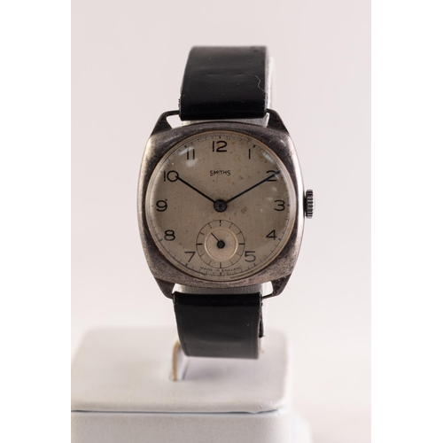 29 - SMITHS, MADE IN ENGLAND, SILVER VINTAGE WRISTWATCH, with 15 jewels movement No C2615, silvered circu...