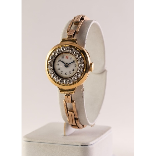 42 - EARLY 20th CENTURY 18ct GOLD CASED LADY'S WRISTWATCH with 15 jewel movement, the besel set with 21 t...