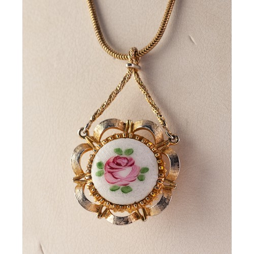 44 - LADY'S COROCRAFT SWISS GOLD PLATED FANCY PENDANT WATCH, the back enamelled with a rose, on a long RO...