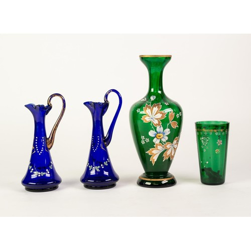 51 - TWO SMALL SAPPHIRE BLUE GLASS ENAMELLED AND GILT DECORATED EWERS, a green tinted enamelled and gilt ...