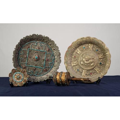 96 - TIBETAN BRASS PRAYER WHEEL inset with turquoise and red stones; TIBETAN EMBOSSED BRASS CIRCULAR PLAQ...