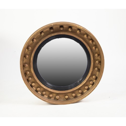 60 - 19th CENTURY GILT CONVEX MIRROR, the circular cavetto frame applied with balls and with an ebonised ...