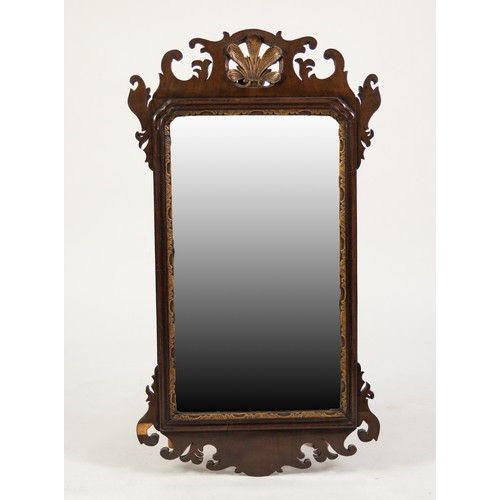 62 - EARLY 20th CENTURY GEORGIAN REVIVAL WALNUT AND PARCEL GILT VERTICAL WALL MIRROR, the plate within a ...