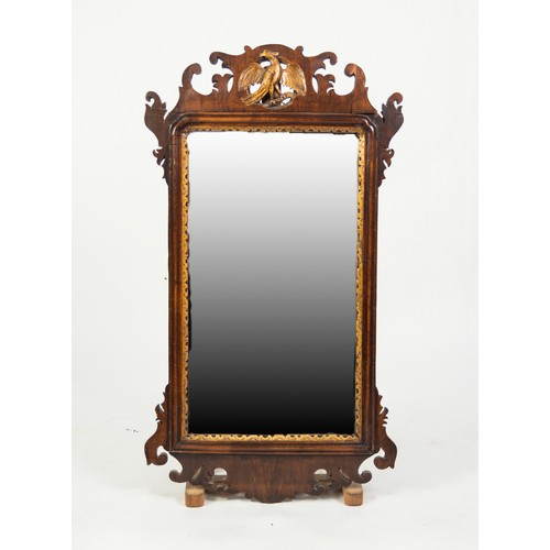 64 - EARLY 20th CENTURY GEORGIAN REVIVAL WALNUT AND PARCEL GILT VERTICAL WALL MIRROR, the plate within a ...