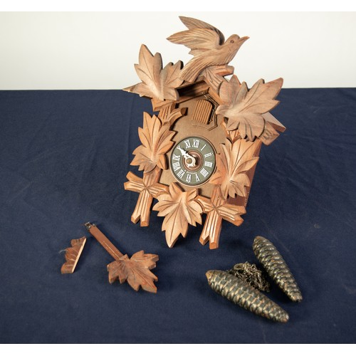 25 - POST WAR SWISS CARVED SOFT WOOD CUCKOO WALL CLOCK, of chalet form with pine cone pattern weights