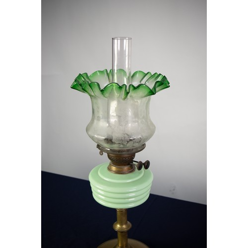 73 - VICTORIAN BRASS AND GREEN GLASS OIL TABLE LAMP, with knopped column, domed base, opaque pale green m...