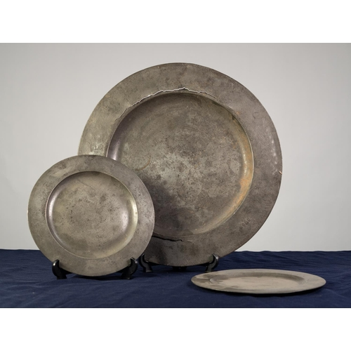 """85 - ANTIQUE PEWTER CHARGER, with broad rim, 17"""" (43.2cm) diameter, together with a PAIR OF ANTIQUE PEWTE..."""