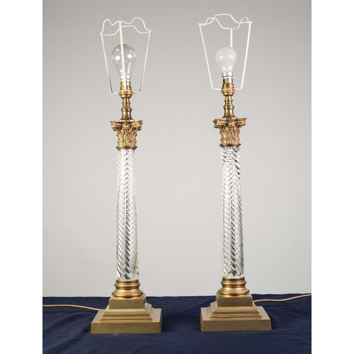 78 - LARGE PAIR OF BRASS AND SPIRAL MOULDED CLEAR GLASS TABLE LAMPS, each of Corinthian column form with ...