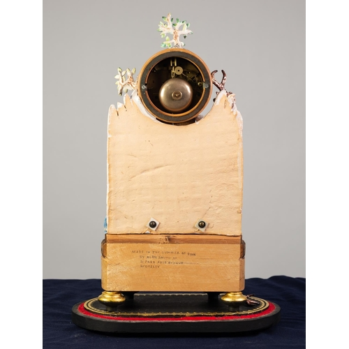 """33 - 'DIANA AND ACTOEON' COMPOSITE POTTERY AND WOOD FIGURAL MANTLE CLOCK, the 3"""" pink porcelain dial with..."""
