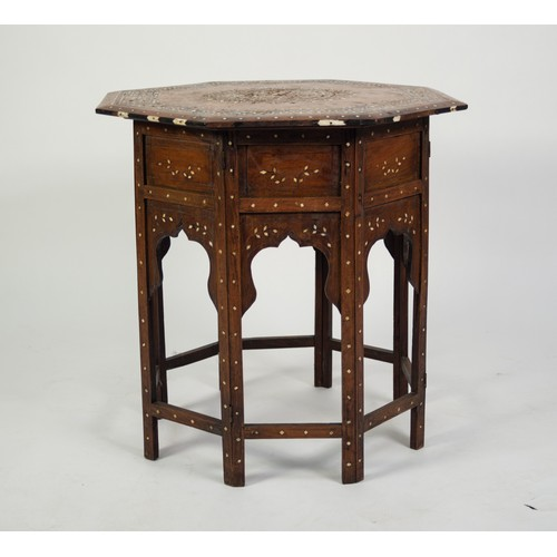 162 - EARLY TWENTIETH CENTURY MIDDLE EASTERN INLAID WALNUT OCCASIONAL TABLE, the octagonal top inlaid with...