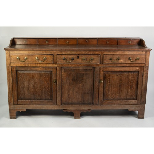 109 - NINETEENTH CENTURY OAK DRESSER, the moulded oblong top with six drawers to the low gallery back, set...