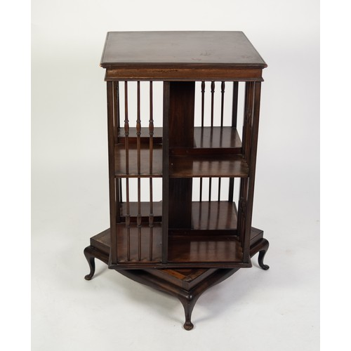 143 - EARLY TWENTIETH CENTURY DARK MAHOGANY REVOLVING BOOKCASE, of typical form with slender, turned divid...