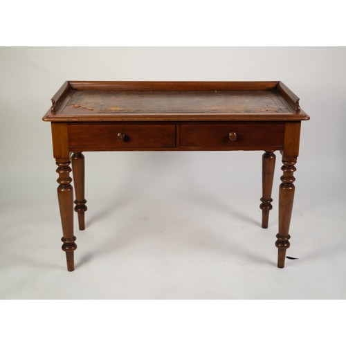 150 - LATE VICTORIAN MAHOGANY WRITING TABLE, the moulded oblong top with three quarter gallery and gilt to...