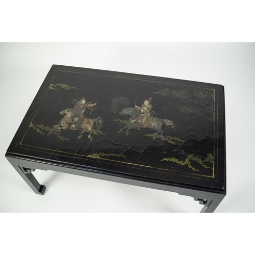 190 - MODERN ORIENTAL BLACK LACQUERED COFFEE TABLE WITH REVERSIBLE TOP, the inset top decorated with a col...