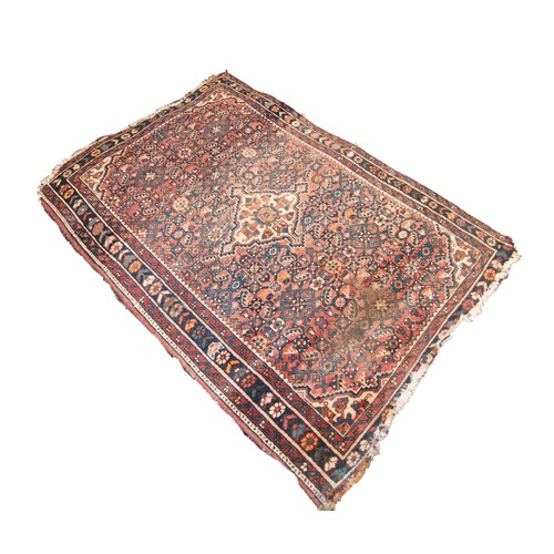 18 - SHIRAZ PERSIAN SEMI-ANTIQUE RUG with diamond shaped white and floral centre medallion with four pend...