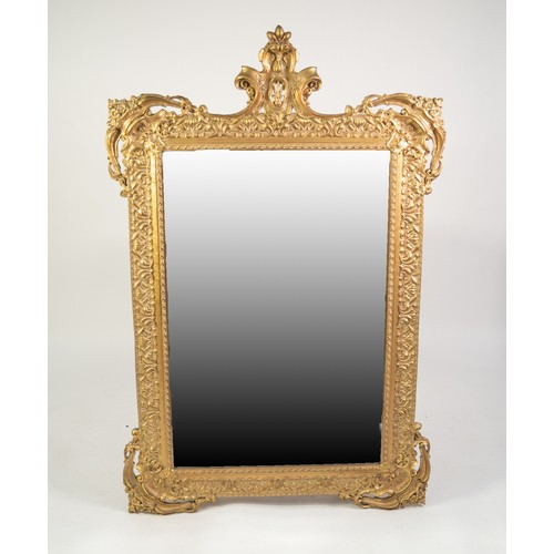 59 - MODERN BAROQUE STYLE MOULDED GILT WALL MIRROR, the bevel edged plate within an ornate frame with pie...