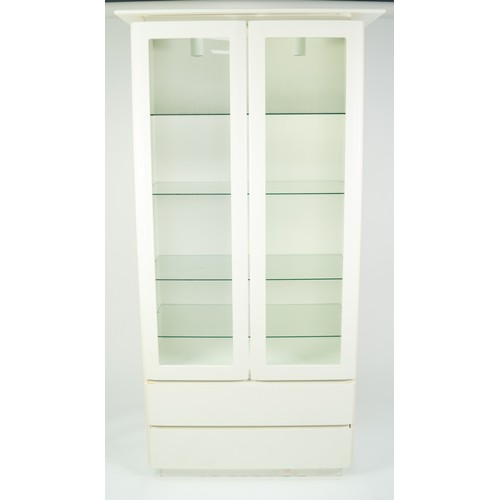 216 - PETER CARLSON INTERIORS WHITE FINISH DISPLAY CABINET, the pagoda top above a pair of glazed cupboard...