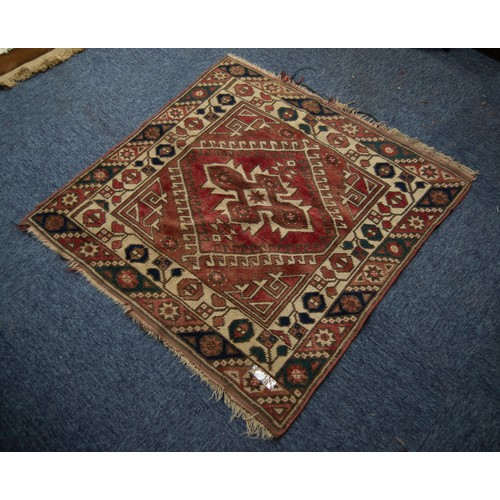 16 - SMALL EASTERN RUG, the red field filled with a centre medallion within a diamond shaped latch hook s...