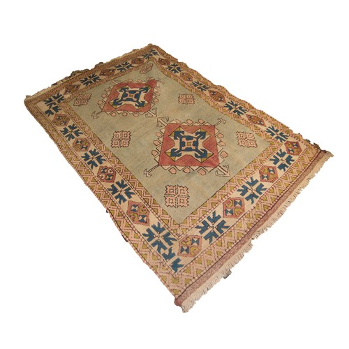 19 - CAUCASIAN LOOSELY WOVEN LARGE RUG with two large diamond shaped medallions with arrow motifs and pen...