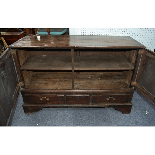 115 - NINETEENTH CENTURY CARVED OAK MULE CHEST PATTERN CUPBOARD, the moulded oblong top above a pair of tw...