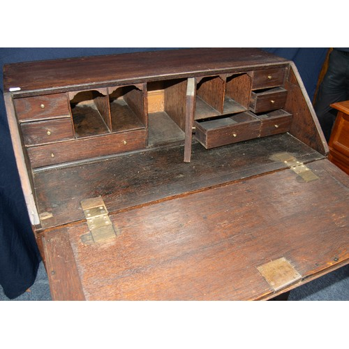 117 - GEORGE III OAK BUREAU, of typical form, the interior fitted with pigeon holes and short drawers encl...
