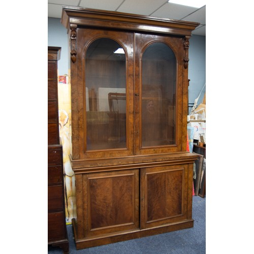158 - GOOD VICTORIAN BURR WALNUT BOOKCASE, the moulded cornice above a pair of cupboard doors, arched and ...
