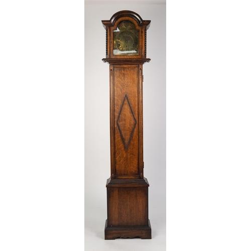 "45 - TWENTIETH CENTURY OAK GRANDMOTHER LONGCASE CLOCK, the 8"" brass Roman dial with mask spandrels and 'T..."
