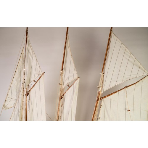 56 - POST-WAR PROPRIETORY PAINTED WOOD MODEL OF A THREE MASTED AND STEAM POWERED SCHOONER, with fabric sa...