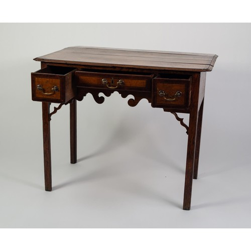 118 - GEORGE III MAHOGANY CROSSBANDED OAK LOW BOY, the moulded top with in-turned fore corners and fall-fl...