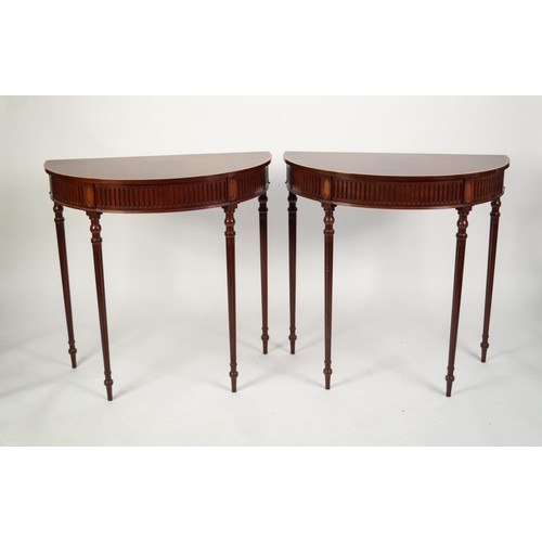 204 - PAIR OF SHERATON STYLE MAHOGANY DEMI-LUNE CONSOL TABLES, with satinwood crossbanded borders, fluted ...