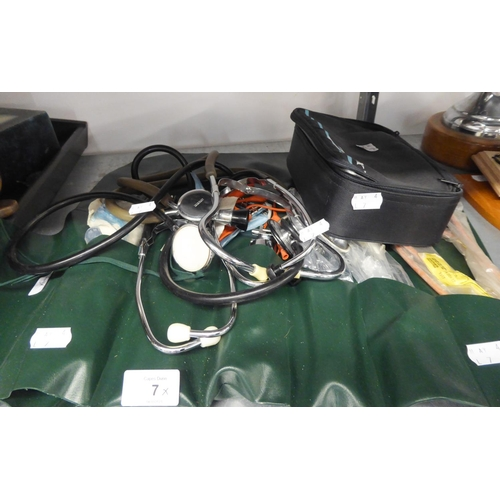 7 - SELECTION OF DOCTORS INSTRUMENTS IN A PLASTIC ROLL INCLUDING 3 STETHOSCOPES ETC...