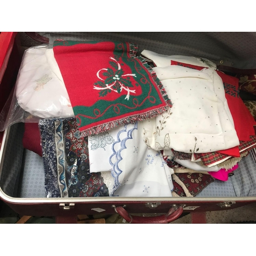 62 - SUITCASE OF MODERN MATERIAL, TABLE CLOTHS ETC