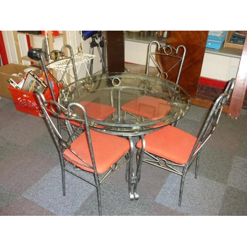 487 - Glass Topped and Wrought Iron Table and Chair Set...