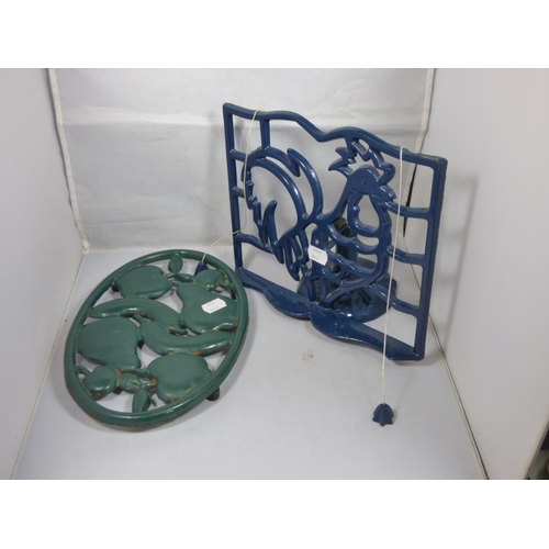 70 - Cast Iron Book Stand and Trivet...