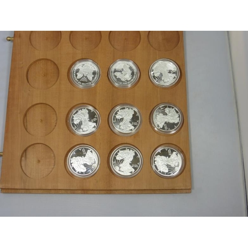 10 - Coin display tray complete with nine Silver plated coins...